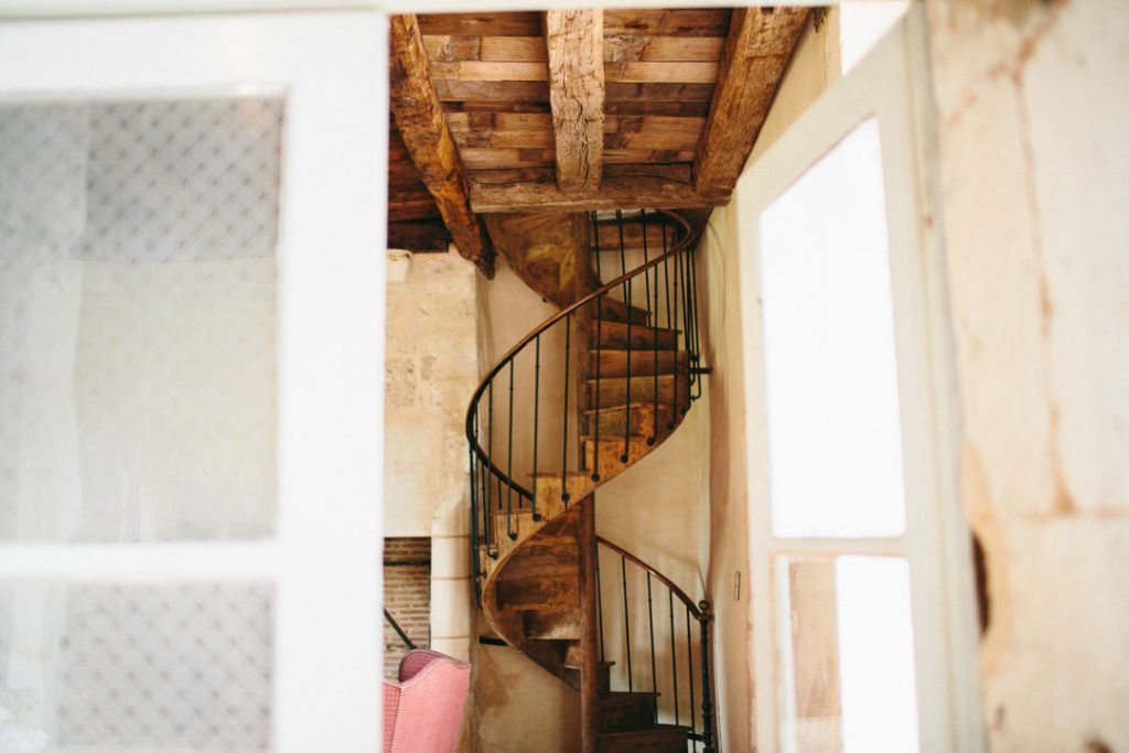 Rustic-French-wedding-venue-spiral-staircase
