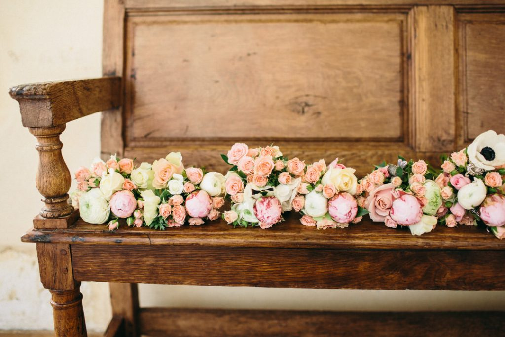 wedding-venue-france-rustic-wood-bench-flowers